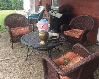 Great outdoor woven chairs, large grill, outdoor pottery, metal outdoor furniture
