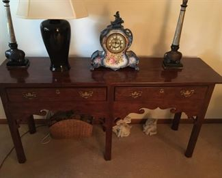 . . . a very nice sofa table -- note the assorted lamps.