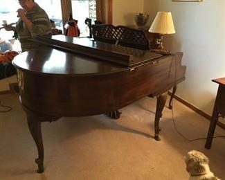 . . . a wonderful Kimbal baby grand piano.