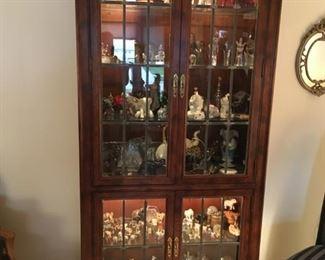 . . . I love this lit curio cabinet.