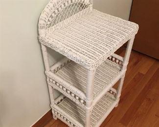 . . . a cute wicker shelf unit.