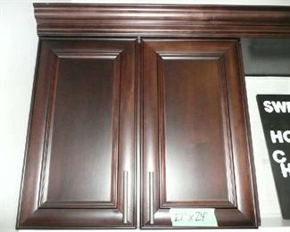 "2-27"" X 24"" includes crown molding."