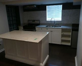 Basement Kitchen Cabinets with Island, Granite Counters, SS Sink & Faucet. $850.00.