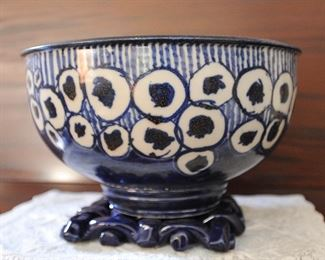 Possibly Dorchester pottery bowl, on ceramic trivet