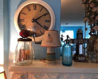 Butter churn.  Key wind clock.  Spritzer bottle
