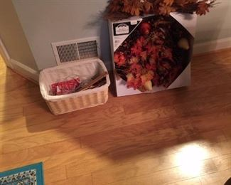 Fall wreath, basket with some knitting needles and crochet hooks and blue rug