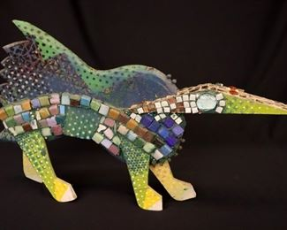 """Nosey Neighbor"" Sculpture. Mixed media sculpture of a four-legged creature, titled Nosey neighbor. Multi-color painted wooden body with applied beads, tiles, and cabochons. No visible signature but numbered ""47"". Minor surface wear, a few missing beads, ½ "" hole drilled in underside for display mounting. Measures 25"" x 16"" high. Reference #K.14"