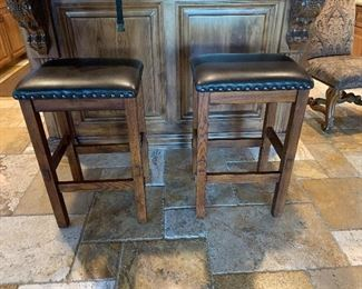 2 bar stools, soon needing new leather or cloth on top.