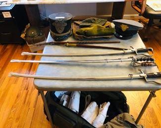 Sabers, swords, batton, vintage hats from West Point, vintage Navy uniforms, pilot's helmet...