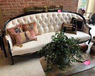 French curved sofa with heavy brass accents