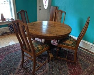 Beautiful oak table with 4 leaves and 4 chairs. Oriental rug sold separate. Make us an offer we can't refuse!!!!!!