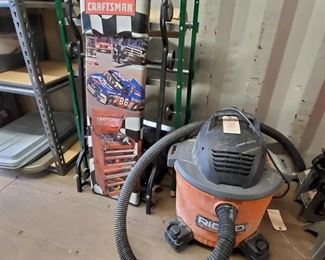 """4014: Craftsman 40"""" Creeper, Motorcraft Rolling Work Seat and more! Also includes Ridgid 9 gallon shop vac with attachments and a shipping paper holder/cutter"""
