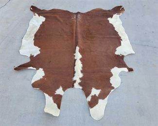 "1031: Cow Hide Rug Measures approx 8'4""x7'"