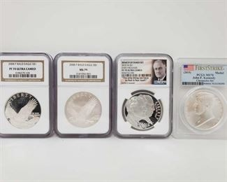 2030: Four .900 Silver Coins Two 2008 P Bald Eagle S$1 .900 Silver Coins. Grades are: MS 70 and PF 70 Ultra Cameo. One 2015 W S$1 March Of Dimes Set PF 70 Ultra Cameo. One 2015 Commemorative Inaugurated President John F. Kennedy Chronicles Set PCGS MS70