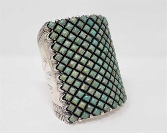 "1099: Huge Amazing Native American Sterling Silver Cuff / Bracelet with Green Turquoise Stones   This artist marked Huge Green Turquoise Cuff  Weight  approx 153.7g Approx 3"" tall and 2.5"" wide.. This is truly an statement piece and will add value ti your collection . This also matches the Squash Blossom Sold earlier  Metal Type: Sterling Silver Gemstones: Turquoise Low Estimate: 2000.00 High Estimate: 3000.00"