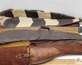 """882: Nine Leather Rifle Cases Measurements range from 36""""-52"""""""