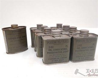 #970 • Nine Metal 2oz Cans of Gun Oil