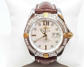 1105: Breitling Diamond Bezel Wrist Watch with Mother of Pearl Face - Authenticated! Measures approx 42mm. Markings on back B49350, 935703