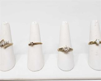 1251: Four 10k Gold Rings, 8.4g Four 10k gold rings All together rings weigh 8.4g Ring sizes are approximately 6.5, 7, 9,