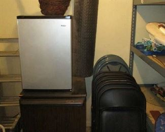 Folding chairs and small refrigerators