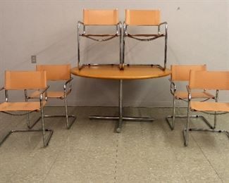 Cantilever Armchairs by Mark Stam, 60 inch stainless steel table
