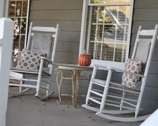 Porch Rockers and distressed metal table.
