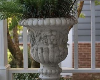 Cast stone container approximately 3' in height.