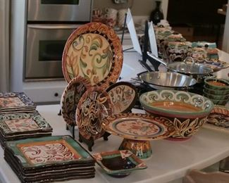 A large suite of Vicki Caroll tableware, handpainted and year dated.