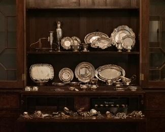 Fine Sterling Silver Collection, many table articles, including partial sets of flatware: Kirk Repousse', Buttercup by Gorham, Lily of the Valley by Whiting, Duchess (Chantilly) by Gorham, W. Adams Coin Silver... all displayed in a grand Secretaire book case.