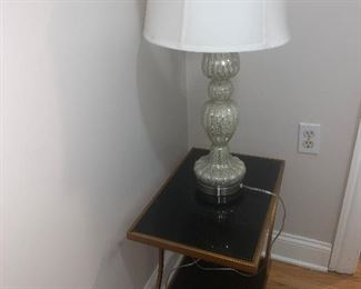 Table lamp and side table with two tiers.