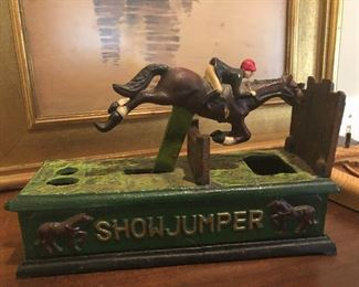 Cast iron show jumper coin bank- NEAT!