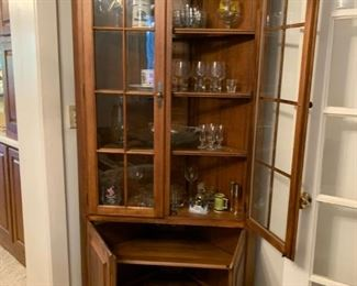 #9		(2) corner display cabinets w/ 2 glass and 2 wood doors 4 shelves 36x21x79 2 @ 175 each