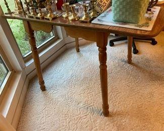 #20laminate wood drop side table 28-45x 30x29 $75.00