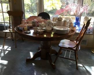 Round oak table and chairs, Metlox Tickled Pink and Denby Gourmet pottery
