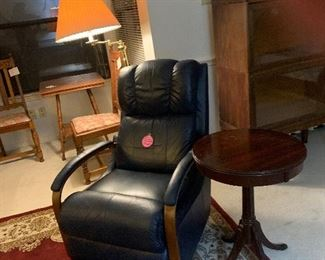 Blue recliner  Deep red carpet Pedastal table