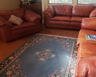 RUGS,2  LEATHER SOFA, OVERSIZE CHAIR AND OTTOMAN