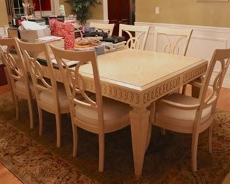 Light Wood and has 8 Chairs & China Cabinet
