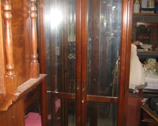 display cabinet with glass shelves and lights