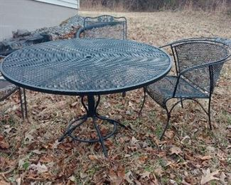 wrought iron patio table, assorted chairs