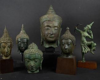 Group of Cambodian Bronze Heads and Buddha