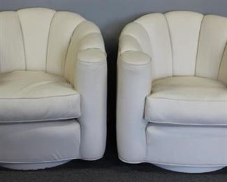 Pair of Leather Upholstered Swivel Chairs