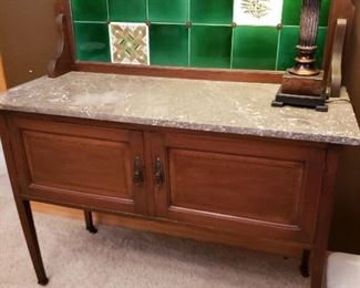 Antique marble-top sideboard with tile backsplash