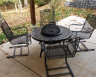 Log burning firepit and four armchairs