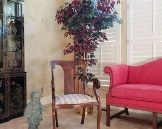 Mahogany armchair and faux ficus tree with statue