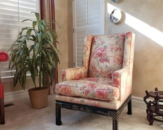 One of a pair of Chinese decorated upholstered wing back chairs