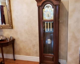 Howard Miller grandfather clock, left side glass has a crack otherwise its in great condition
