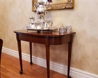 Mahogany side table with silverplate coffee and tea service and a hot water urn together with a tray