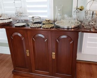 Mahogany flip top server with silverplate and glass serving pieces