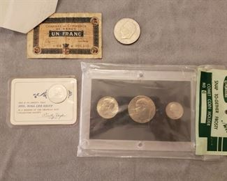 Money including a Franc with a note from when it was received