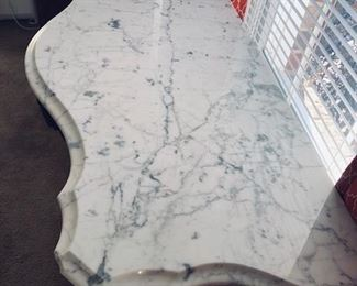 Closeup of the marble top with beveled edge